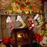 fireplace christmas decorations for mantels with stocking ornaments and wreath and candles plus flowers vase with small christmast tree