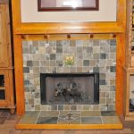fireplace mantel height in wooden with attractive ceramic tiles and mirror on tops decorated with wooden cabinets and tile for floor