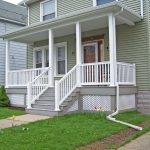 front porch idea with white wood railing as fence system and stairs railing