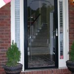 full transparent glass screen door with black wood frame sidelights with window blinds