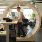 futuristic round zone standing desk design with wooden countertop and metal leg and spherical canopy in computer