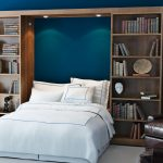 Gorgeous Flod Up Wall Bed Design On Blue Wall Between Wooden Storage Aside Leather Chair Beneath White Floor Lamp With White Sheet