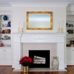 gorgeous interior design with white fireplace mantel design with white built in bookshelves with wooden laminated floor