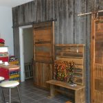 gorgeous rustic wooden barn door idea on rustic wooden wall with rustic bench storage and white table with stool and wooden racks