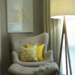 half seating reading chair for bedroom at the corner with unique standing lamp and yellow cushions and blanket plus picture on wall decoration