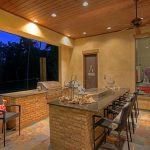 hibachi grill for home backyard kitchen with brick island and cool chairs plus wooden ceiling with fan and lamps plus granite countertop