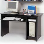 ikea computer desks for small spaces in black plus sliding panel for keyboard and storage for CPU plus monitors for home office