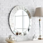impresive round sheffield home mirrors with stunning frame combined with alarm clock and table lamps plus egg ornament and brick pattern white wall