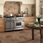 impressive kitchen design with tile flooring options for kitchens and wooden cabinets and curved wooden table at the center