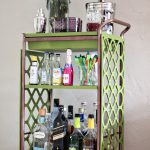 inspiring bar carts ikea in green with flower vases and metal jar and cocktail glasses and liqours on tililing floor and white wall paint