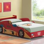 inspiring car beds for toddlers with wooden bed frame and soft bedding plus rug on floor plus cute pictures on wall decoration