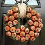 inspiring pottery barn wreaths with fall pumpkin and grenerry tied with ribbon on front door