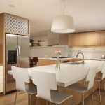 large kitchen islands with seating and storage with glossy surface top and pendant lighting plus wooden laminate floor plus wooden cabinets
