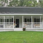 larger front porch with furniture in left and right sides small outdoor stairway without railings vertical wood railings for porch in white color