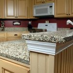 leopard patterned cheap countertop idea above beige woooden cabinet and red backsplash design with sophisticated kitchen set