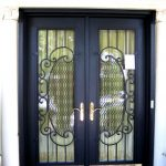 luxurious and black elegant screen door with crafted metal decoration