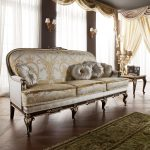 luxurious and elegant sofa in classic style with stylish round pillows a  rug for wood planks wood floors a classic console table with classic table lamp a pair of double cap lightings for wall