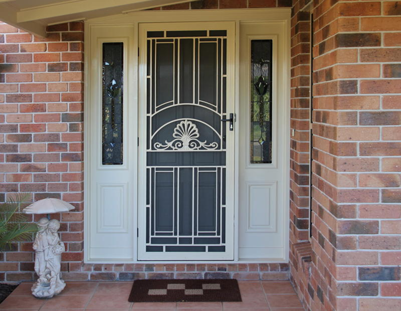 Unique home designs security doors homesfeed for Decorative storm doors with screens