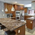 luxurious granite kitchen island marble kitchen countertop a marble top table for electric stove metal electric kitchen appliances three bacless barstools three metal pendant lamps