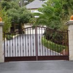 luxurious iron gate in brown tone color a pair of gate lighting fixtures