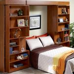 Luxurious White Brown Fold Up Wall Bed Design With Yellow Quilt Between Large Wooden Storage Design Beneath White Wall Upon White Floor