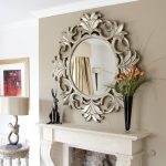 luxury round sheffield home mirrors  for hallways plus golden frame with vase and art display on fireplace plus vintage end table with unique table lamp