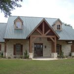 medium size Texas Hill Country home design with log pillars construction and metal roofs