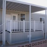minimalist porch with vertical wood railing in white color for mobile house style