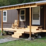 mobile home with wood floor porch and single wood rocking chair for porch