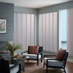 modern and simple window covering for sliding glass door with vertical blinds in living room with traditional chairs and round wooden table