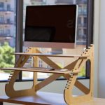 modern and stunning standing desk design with unique shape of sunglasses with texture and double racks beneath large glass window