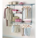 modern closet furniture ideas with steel shelf with hanging rod plus cute boxes and pink hat on white wall