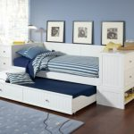 modern-daybed-with-trundle-design-ideas-with-white-drawers-design-and-blue-rug-with-laminate-flooring-design-ideas-and-blue-wall-design-ideas-and-bedroom-storage-design-with-lamp-side-and-glass