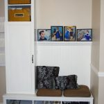 modern mudroom storage units in wood with storage and built in bench with pretty cushions plus photograph on wall decorations and drawers plus shoes storage