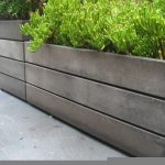 modern sophisticated outdoor concrete planter boxes design with plaid horizontal pattern with modern greenery