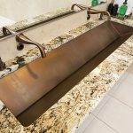Modern Troff Sink With Marble Countertops Plus Golden Faucet And Mirror On Wall For Modern Bathroom Ideas