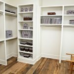modern white walk in closet with shelf with stainless steel hanging rodhard wood flooring and wooden chair for home furniture ideas