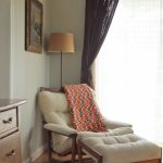most comfortable tufted reading chair with foot stool decorated with blaket and lamp shade near the window with impressive curtain