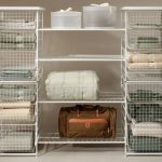 movable modern linen closet design made of wire basket and net with racks and closed slots with bags and plastic box