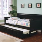 Pictures Of Black Wooden Daybeds With Trundle And Storage Underneath Plus Comfy Bedding And Modern Rug On Wooden Floor