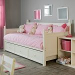 pictures of daybeds for girl with pink bedding and cushion plus bear and nightstand with pink lamp and wooden floor plus wooden cabinets