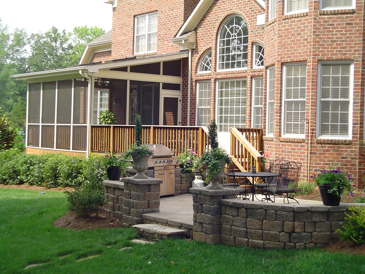 Enjoy contended relaxing moments by designing screened in for Brick porch designs for houses