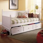 pictures of wooden daybeds in white with striped bedding and cute cushions plus drawers or storage underneath plus rug and wooden flooring