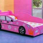 pink race car beds for toddlers and girl in wooden bed frame with girly bedding set and gray floor plus glass window and pink orange wall scheme