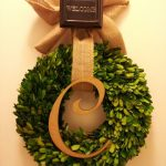 pottery barn wreaths for home decoration with brown ribbon and greenery plus hanger