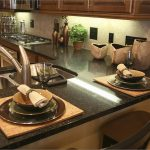 price of black galaxy granite countertops with kichen sink plus stylish dining set and kitchen island with comfy seating plus gas stove and tile blacksplash