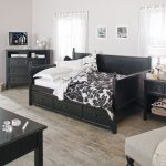 queen size daybed frame with black wooden frame and drawer storage underneath and cabinets shelves and nightstand with drawer and hardfloor