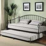 queen size daybed frame with metal frame and double stripped bed and pillow plus rug on the wooden laminate floor plus pictures on wall decoration
