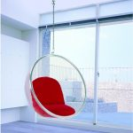 Red Bubble Eero Aarnio Chairs That Hang From The Ceiling From Glass In Living Room With Glass Windows