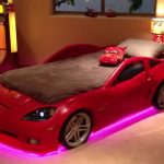 red car beds for toddlers with brown bedding set and led lighting under the bed and table lamp plus picture on wall